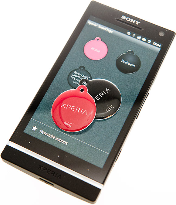 Black and red Xperia SmartTags on the Xperia S